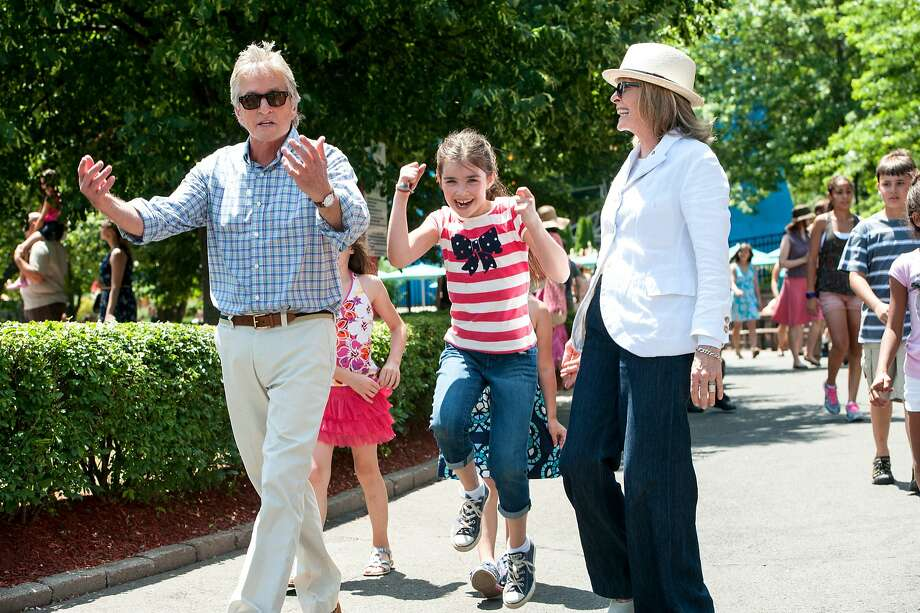 """Michael Douglas, Sterling Jerins and Diane Keaton enjoy an afternoon at an amusement park in Rob Reiner's romantic comedy """"And So It Goes."""" Photo: Clay Enos, Clarius Entertainment"""