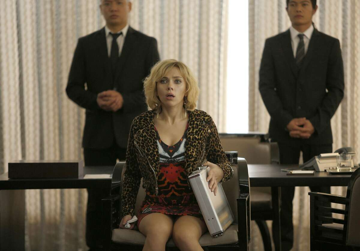 Lucy (SCARLETT JOHANSSON) is temporarily held hostage by thugs in