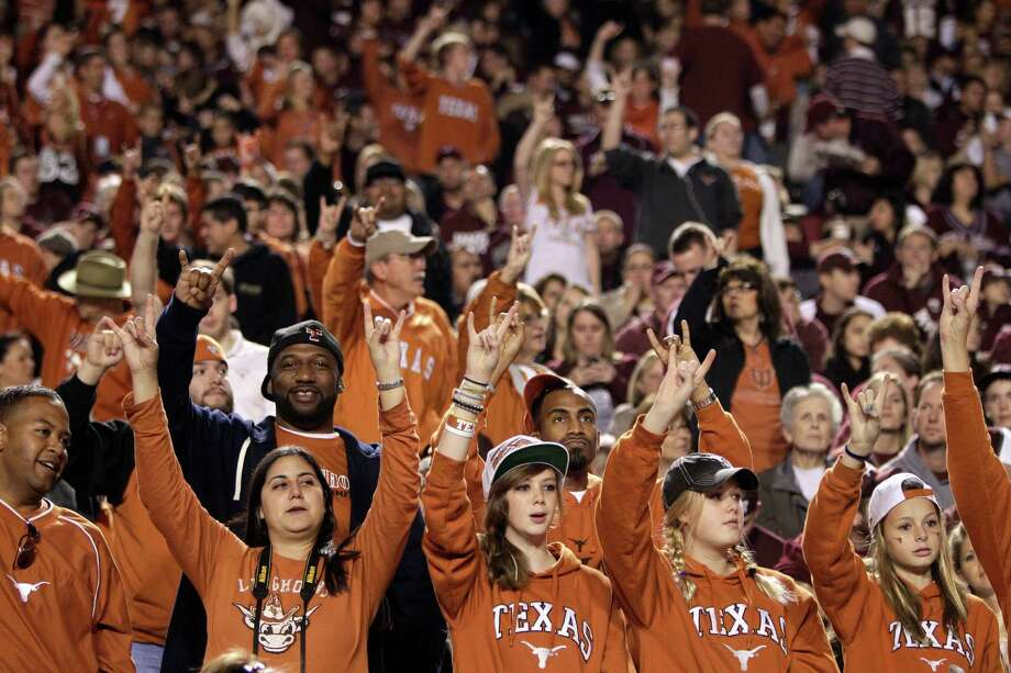 Texas fans show a Hook 'Em sign during the first quarter of an NCAA college football game against Texas A&M at Kyle Field Thursday, Nov. 24, 2011, in College Station. ( Brett Coomer / Houston Chronicle ) Photo: Brett Coomer, HC Staff / © 2011 Houston Chronicle