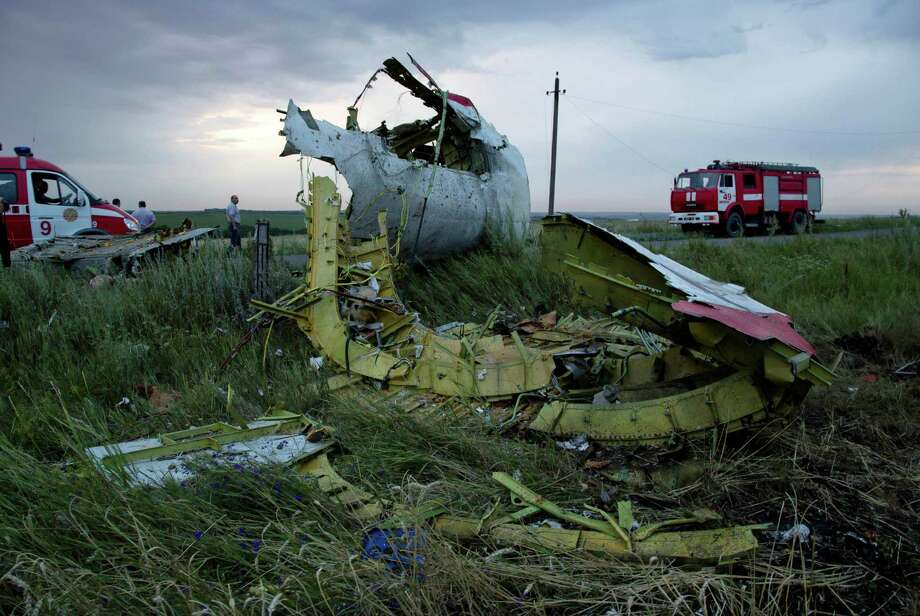 FILE - In this Thursday, July 17, 2014 file photo, firefighters arrive at the crash site of a passenger plane near the village of Hrabove, Ukraine. All 298 people aboard the Malaysia Airlines Flight 17 traveling from Amsterdam to Kuala Lumpur were killed. (AP Photo/Dmitry Lovetsky) Photo: Dmitry Lovetsky, STF / AP