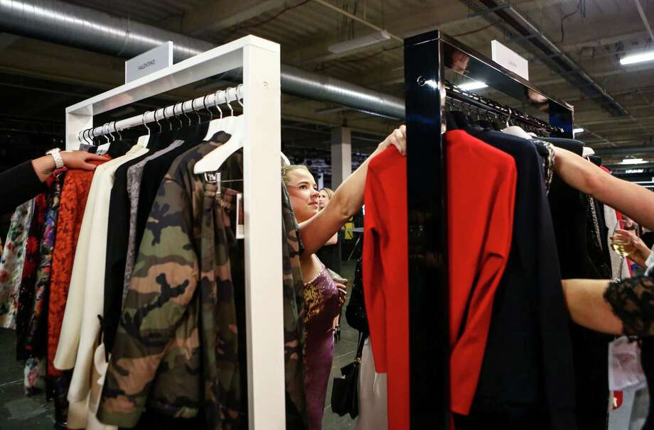 """Guests browse the clothing during the annual Nordstrom Designer Preview fashion show at Smith Cove Event Center at Pier 91 in Seattle. The event helped raise funds for Seattle Art Museum and incorporated elements of  the Museum's upcoming exhibit """"Pop Departures"""" into the show. Photographed on Thursday, July 24, 2014. Photo: JOSHUA TRUJILLO, SEATTLEPI.COM / SEATTLEPI.COM"""