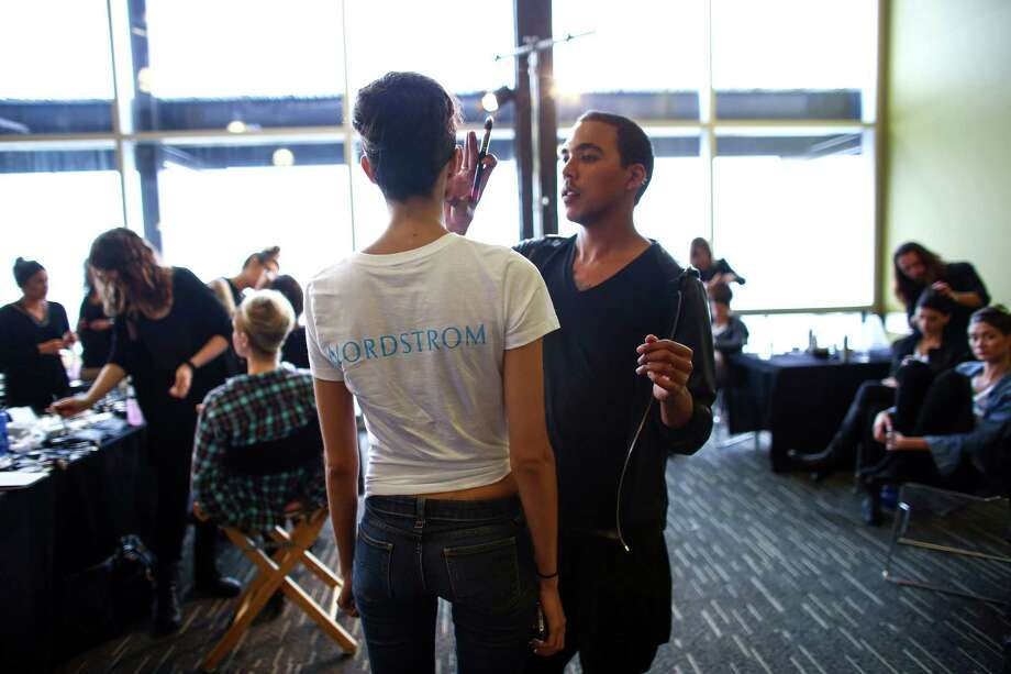 "Models get hair and makeup done backstage during the annual Nordstrom Designer Preview fashion show at Smith Cove Event Center at Pier 91 in Seattle. The event helped raise funds for Seattle Art Museum and incorporated elements of  the Museum's upcoming exhibit ""Pop Departures"" into the show. Photographed on Thursday, July 24, 2014. Photo: JOSHUA TRUJILLO, SEATTLEPI.COM / SEATTLEPI.COM"