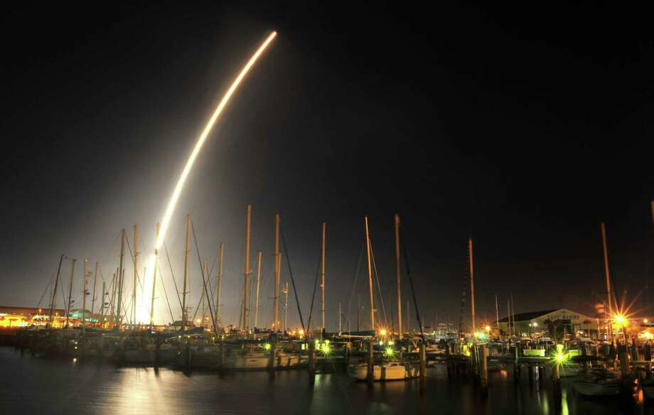 A rocket carrying a GPS satellite launches from Cape Canaveral in February. SpaceX is suing to get a part of the military satellite business. Photo: Malcolm Denemark / Associated Press / Florida Today