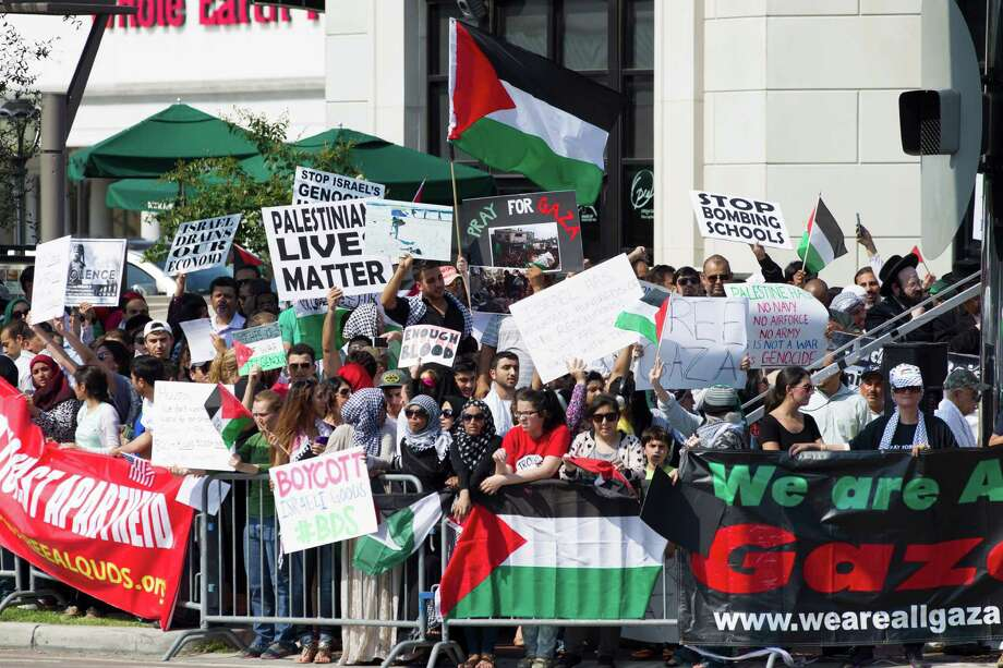 Pro-Palestinian supporters rally at the corner of Westheimer and Post Oak on Friday. Photo: Brett Coomer, Houston Chronicle / © 2014 Houston Chronicle