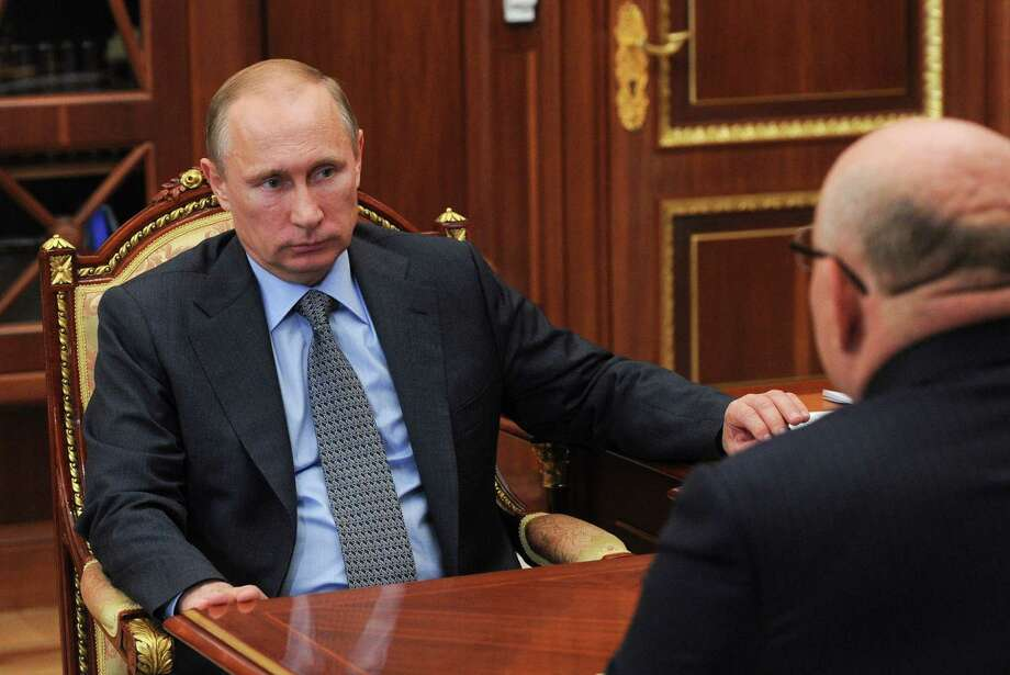 Russian President Vladimir Putin meets with Head of the Jewish autonomous region Alexander Vinnikov in the Kremlin in Moscow, Friday, July 25, 2014. (AP Photo/RIA-Novosti, Mikhail Klimentyev, Presidential Press Service) ORG XMIT: MOSB101 Photo: Mikhail Klimentyev / RIA Novosti Kremlin