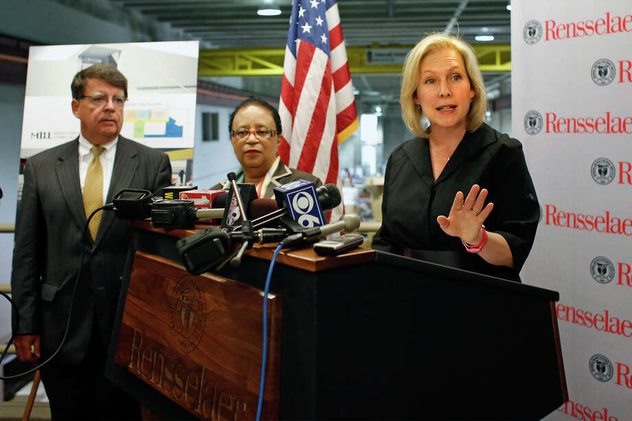 Senator Kirsten Gillibrand, right, announced legislation to move research in the Capital Region into successful small businesses to create new jobs Monday, July 21, 2014, during a media event with RPI president Shirley Jackson, center, at the Low Center for Industrial Innovatio in Troy, N.Y.  (Tom Brenner/ Special to the Times Union) Photo: Tom Brenner / ©Tom Brenner/ Albany Times Union