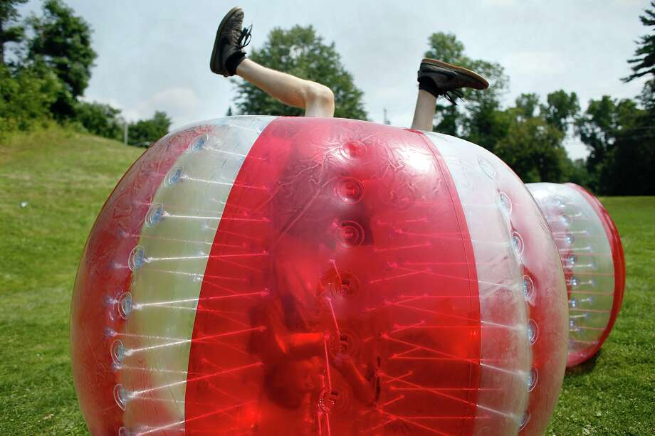 Ben Gazdik does a handstand inside of his inflatable bubble at Camp Extreme on Friday, July 25, 2014, at Academy of the Holy Names in Albany, N.Y. Camp participants played a game of inflatable soccer. (Tom Brenner/ Special to the Times Union) Photo: Tom Brenner / ©Tom Brenner/ Albany Times Union