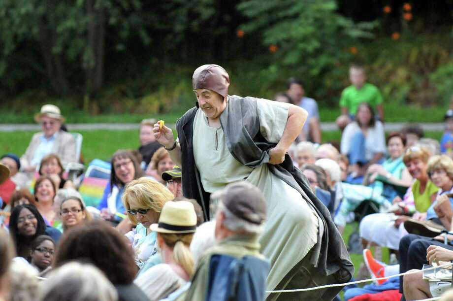 Duncan, King of Scotland, portrayed by John Romeo, tiptoes through the audience just before he's assassinated during Saratoga Shakespeare Company's performance of Macbeth on Friday, July 25, 2014, at Congress Park in Saratoga Springs, N.Y. Final show times are Saturday at 6 p.m. and Sunday at 3 p.m. (Cindy Schultz / Times Union) Photo: Cindy Schultz / 00027716A