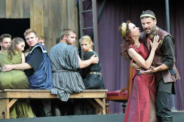 Macbeth, portrayed by Tim Dugan, right, and Lady Macbeth, portrayed by Amy Prothro, perform during Saratoga Shakespeare Company's performance of Macbeth on Friday, July 25, 2014, at Congress Park in Saratoga Springs, N.Y. Final show times are Saturday at 6 p.m. and Sunday at 3 p.m. (Cindy Schultz / Times Union) Photo: Cindy Schultz / 00027716A