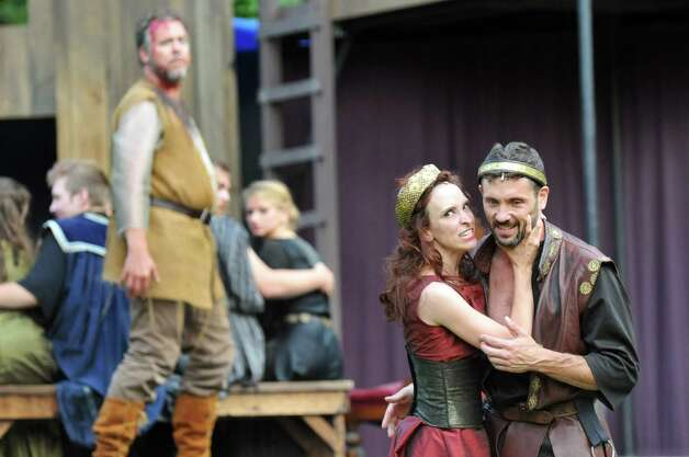 Macbeth, portrayed by Tim Dugan, right, and Lady Macbeth, portrayed by Amy Prothro, perform during Saratoga Shakespeare Company's performance of Macbeth on Friday, July 25, 2014, at Congress Park in Saratoga Springs, N.Y. At left is the ghost of Banquo, portrayed by David Baecker. Final show times are Saturday at 6 p.m. and Sunday at 3 p.m. (Cindy Schultz / Times Union) Photo: Cindy Schultz / 00027716A