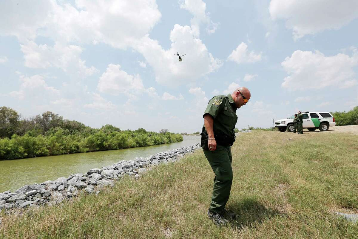 Border Patrol Agent Supervisor Robert Garza looks for signs of border-crossers Thursday along the Rio Grande in Hidalgo County, which has seen the lion's share of the recent migrant influx.