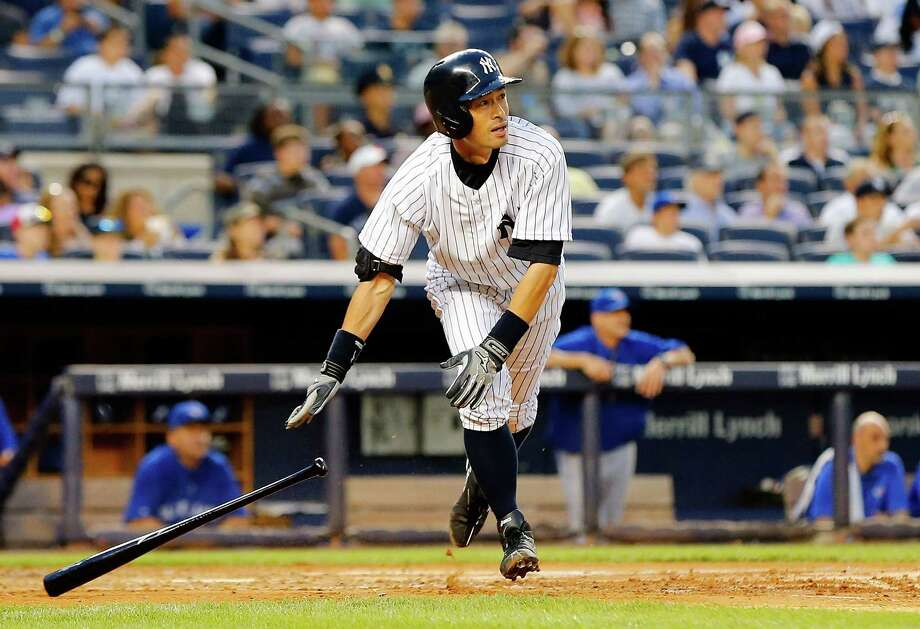 NEW YORK, NY - JULY 25:  Ichiro Suzuki #31 of the New York Yankees follows through on a third inning three run home run against the Toronto Blue Jays at Yankee Stadium on July 25, 2014 in the Bronx borough of New York City.  (Photo by Jim McIsaac/Getty Images) ORG XMIT: 477586809 Photo: Jim McIsaac / 2014 Getty Images