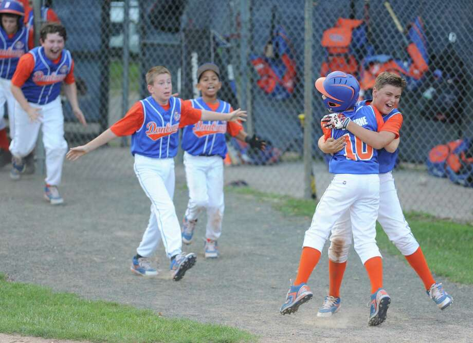 Photos from Danbury's 5-4 extra-innings walk-off win over Newtown in the Cal Ripken baseball league 11 year old, 70' diamond state championship at Rogers Park in Danbury, Conn. Friday, July 25, 2014. Photo: Tyler Sizemore / The News-Times