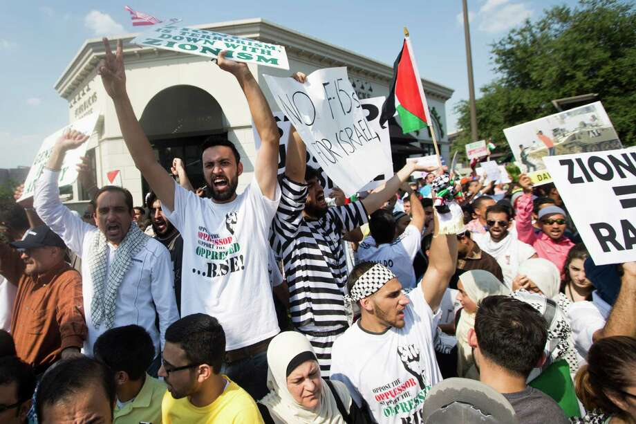 Palestinian supporters stage a demonstration at Westheimer and Post Oak near the Galleria on Friday. Photo: Brett Coomer, Staff / © 2014 Houston Chronicle