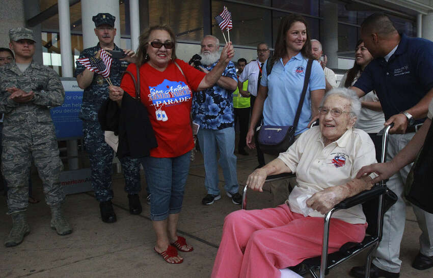 World War II veteran Lucy Coffey arrives at the San Antonio International Airport before heading to Washington, D.C., to view the war memorials built to honor her and other veterans' service and sacrifice.