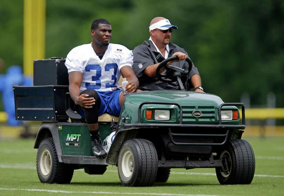 Colts running back Vick Ballard rides off the field on a cart after suffering a lower leg injury Friday during the team's training camp practice. Photo: Michael Conroy, STF / AP