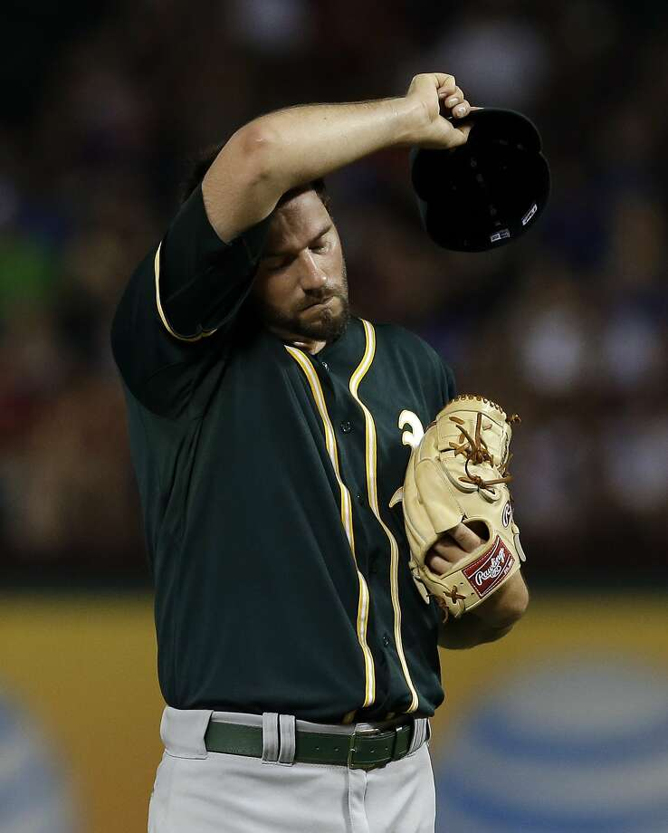Jason Hammel feels the heat - 98 at game time - in Texas. Photo: Associated Press
