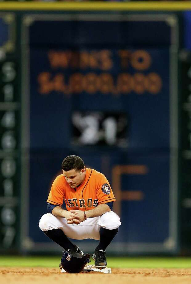 Jose Altuve rests on second base and awaits his verdict - safe or out - on a challenged stolen base call in the sixth. Like the Astros', it wasn't to be his day. Photo: Karen Warren, Staff / © 2014 Houston Chronicle