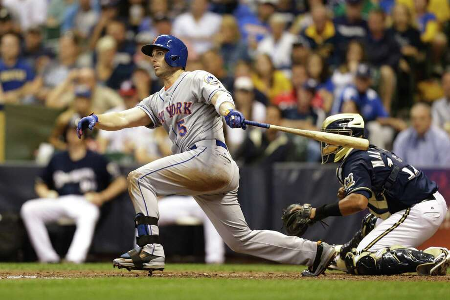 MILWAUKEE, WI - JULY 25: David Wright #5 of the New York Mets hits a RBI single in the top of the ninth inning against the Milwaukee Brewers at Miller Park on July 25, 2014 in Milwaukee, Wisconsin. (Photo by Mike McGinnis/Getty Images) ORG XMIT: 477586861 Photo: Mike McGinnis / 2014 Getty Images