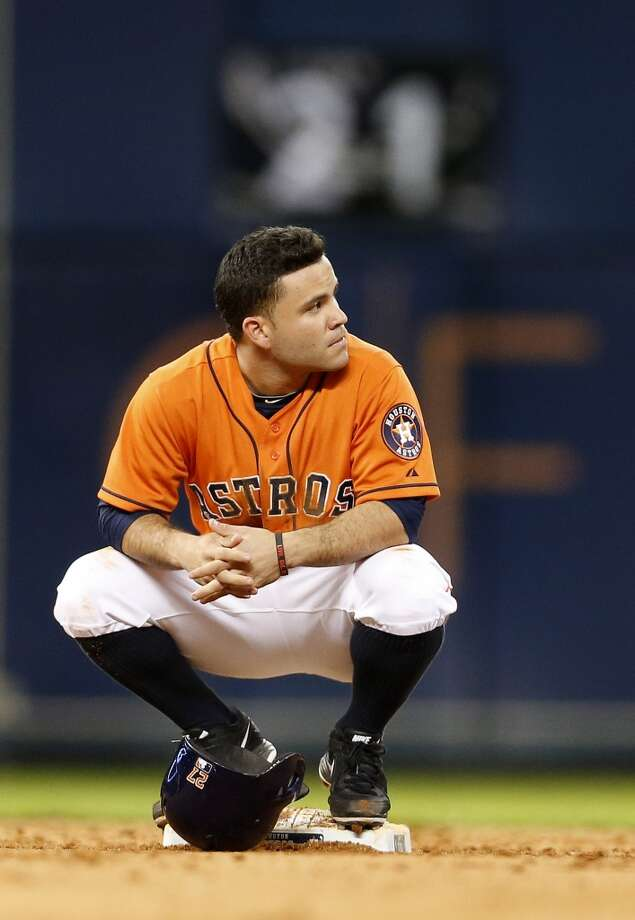 July 25: Marlins 2, Astros 0  Jose Altuve sits on second base as his stolen base was challenged, and overturned, during the sixth inning. Photo: Karen Warren, Houston Chronicle