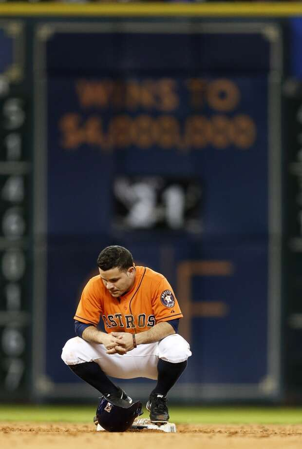 Jose Altuve (27) sits on second base as his stolen base was challenged, and overturned, during the sixth inning. Photo: Karen Warren, Houston Chronicle