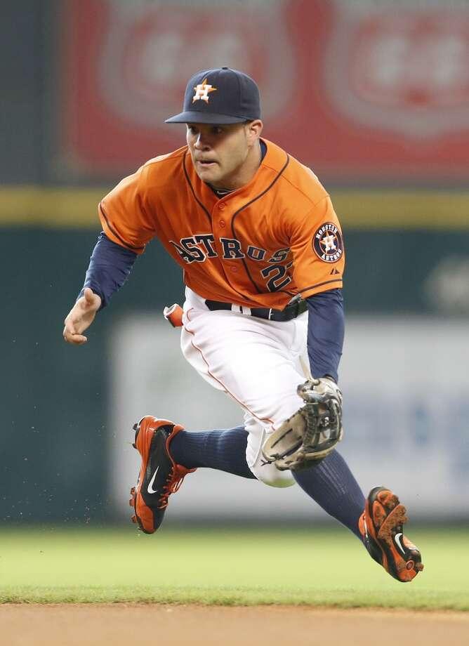 Jose Altuve  runs to catch a ground ball during the first inning. Photo: Karen Warren, Houston Chronicle