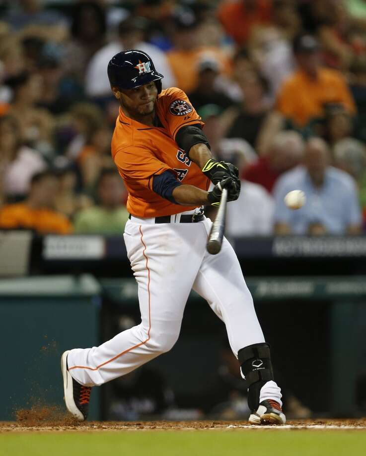 Gregorio Petit hits during the third inning. Photo: Karen Warren, Houston Chronicle