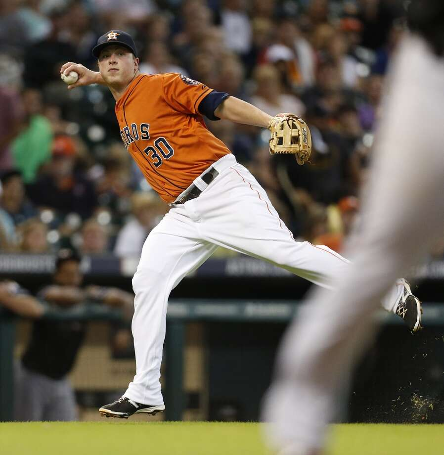 Matt Dominguez tries to make an off-balance throw to first base during the fourth inning. Photo: Karen Warren, Houston Chronicle
