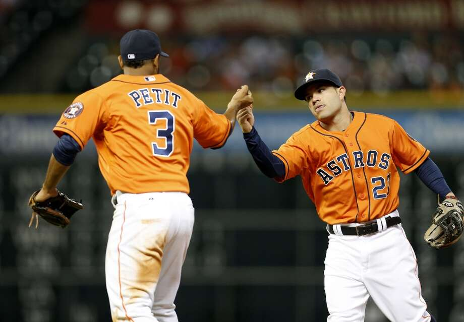 Jose Altuve, right, and Gregorio Petit celebrate the end the top of the fifth inning. Photo: Karen Warren, Houston Chronicle