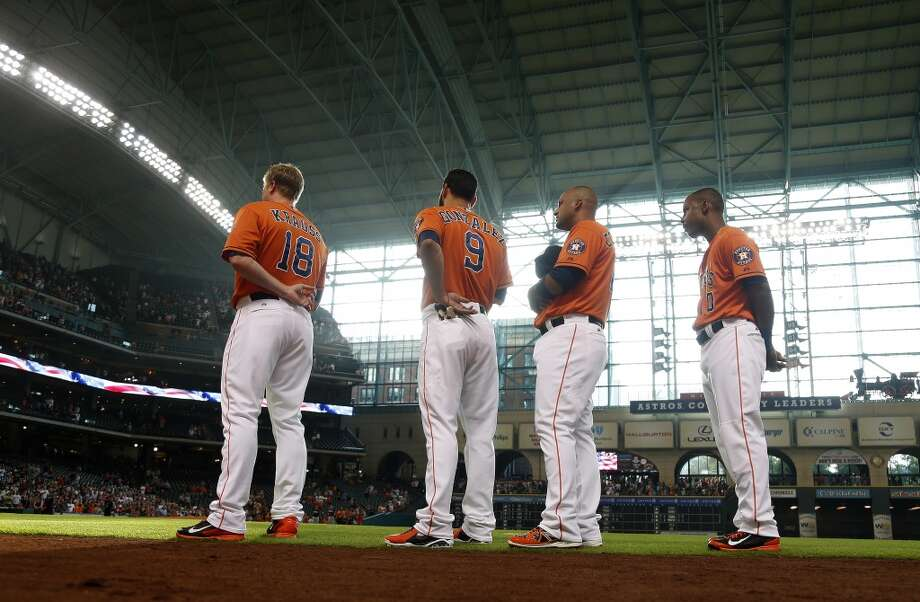 From left to right, Marc Krauss, Marwin Gonzalez, Carlos Corporan and L.J. Hoes during the National Anthem. Photo: Karen Warren, Houston Chronicle