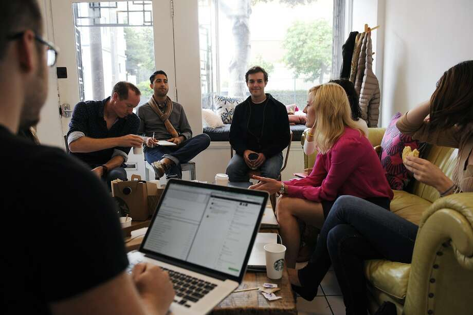 "Near Me employees meet at Makeshift Society in San Francisco's Hayes Valley area. The startup offers a ""just add water"" platform for companies that want to be the next Airbnb of anything in collaborative commerce. Photo: Craig Hudson, The Chronicle"