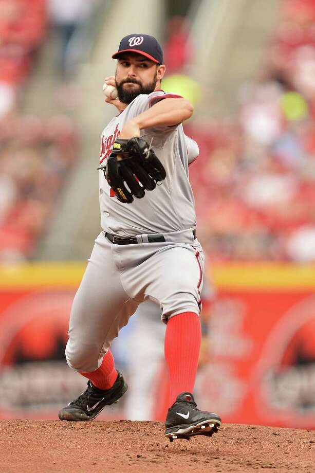 CINCINNATI, OH - JULY 25: Tanner Roark #57 of the Washington Nationals pitches in the first inning against the Cincinnati Reds at Great American Ball Park on July 25, 2014 in Cincinnati, Ohio. (Photo by Jamie Sabau/Getty Images) ORG XMIT: 477586859 Photo: Jamie Sabau / 2014 Getty Images