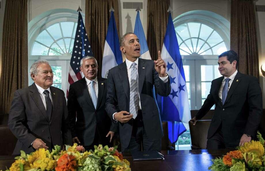 At the summit were presidents of El Salvador, Salvador Sanchez Ceren (from left); Guatemala, Otto Perez Molina; the U.S., Barack Obama; and Honduras, Juan Orlando Hernandez. Photo: Brendan Smialowski / Getty Images / AFP