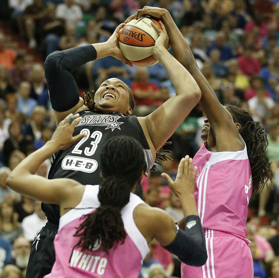 The Stars' Danielle Adams has her shot stuffed by Devereaux Peters (right) in a loss to the defending champion Lynx. Adams, a Texas A&M product, had seven points. Photo: Stacy Bengs / Associated Press / FR170489 AP