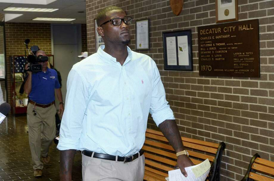 Cowboys linebacker Rolando McClain leaves court in Decatur, Ala., after being convicted of resisting arrest and disorderly conduct. He also was fined $1,572, but plans to appeal. Photo: John Godbey / Associated Press / The Decatur Daily