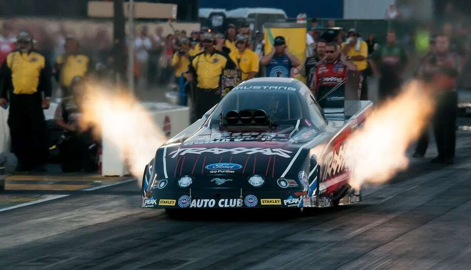 Courtney Force, above, along with her sister Brittany, lead their respective classes in the NHRA Sonoma Nationals. Courtney leads the Funny Car field; Brittany leads the Top Fuel class. Photo: Mike Finnegan