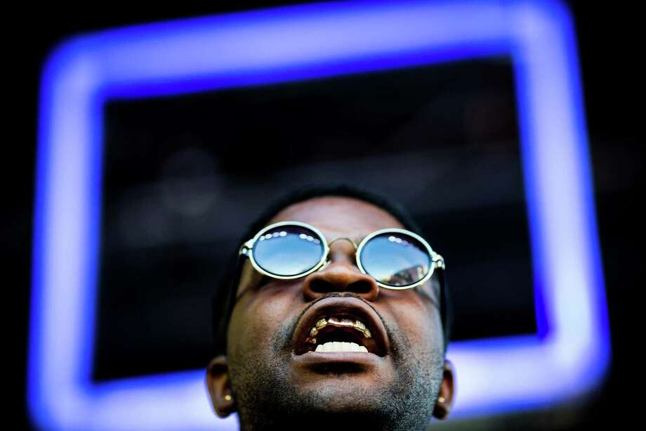 Gold teeth glinting in the afternoon light, A$AP Ferg performs on the first of three days of the annual Capitol Hill Block Party Friday, July 25, 2014, in Seattle, Wash. Photo: JORDAN STEAD, SEATTLEPI.COM / SEATTLEPI.COM