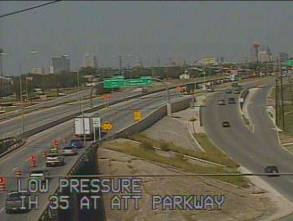 Traffic slows on Interstate 35 South at AT&T Parkway Saturday morning, July 26, 2014. The lanes of I-35 were closed to allow crews to remove a beam from the North New Braunfels overpass bridge.