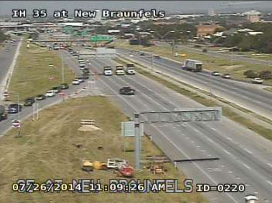 Traffic exits Interstate 35 South at New Braunfels Avenue Saturday morning, July 26, 2014. The lanes of I-35 were closed to allow crews to remove a beam from the North New Braunfels overpass bridge. Photo: Texas Department Of Transportation