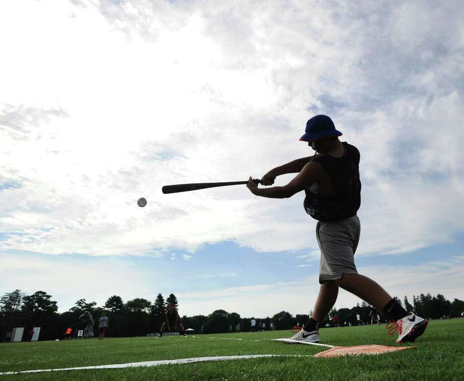 Jake Cohen of the Eastern Computer Eagles, a Greenwich team, connects for hit during a game against Marky Mark & the Funky Bunch, also a Greenwich team, during the annual Greenwich Wiffle Ball Tournament at the Greenwich Polo Club, Conyers Farm, Greenwich, Conn., Saturday, July 26, 2014. Photo: Bob Luckey / Greenwich Time