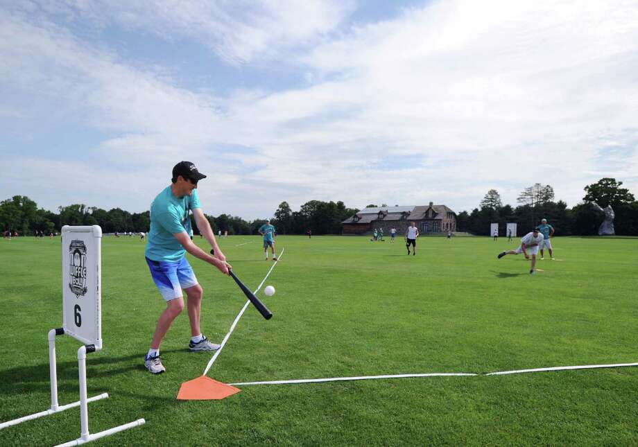 Brant McKee of the Garden Weasels 2.0 team of Darien hits during the annual Greenwich Wiffle Ball Tournament at the Greenwich Polo Club, Conyers Farm, Greenwich, Conn., Saturday, July 26, 2014. Photo: Bob Luckey / Greenwich Time