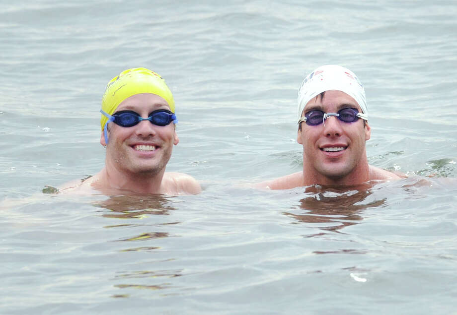 At left, Tim Lovett of Greenwich and Trevor Stanco of Norwalk, in Greenwich Cove off  the Riverside section of Greenwich, Conn., Saturday, July 26, 2014.  Both swimmers are attempting to swim across the English Channel at the end of August. Photo: Bob Luckey / Greenwich Time