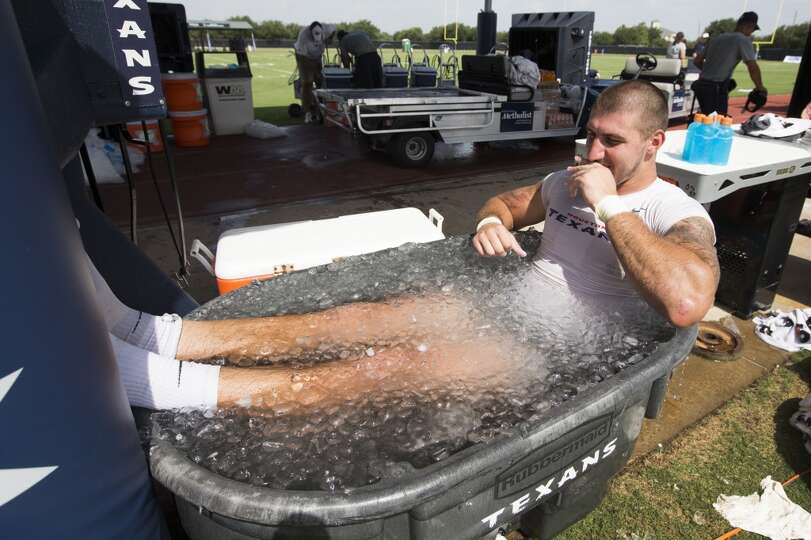 Day 1: July 26  Tight end C.J. Fiedorowicz sits in a tub of ice wat