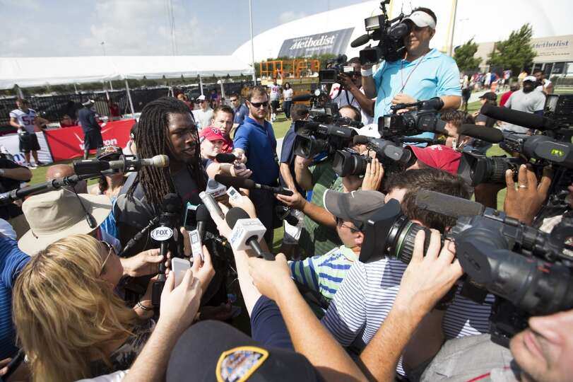 Day 1: July 26  Linebacker Jadeveon Clowney is surrounded by media