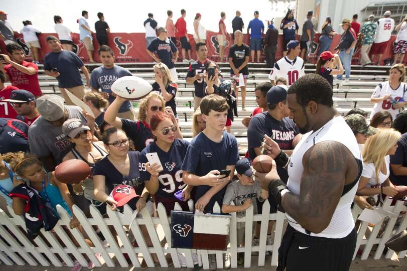 Day 1: July 26  Left tackle Duane Brown signs autographs following