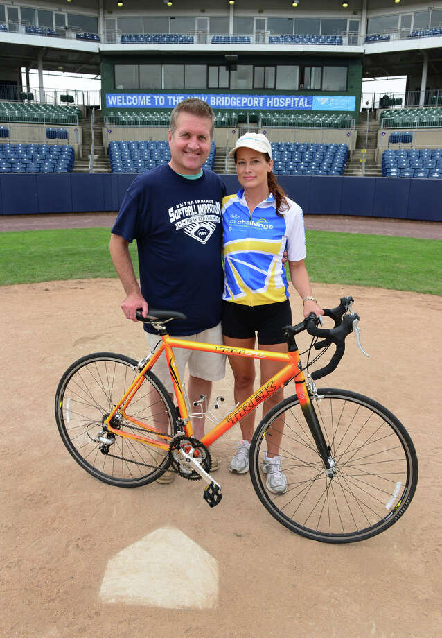 Bluefish baseball's General Manager Ken Shepard poses at the baseball stadium with his wife Tonya in Bridgeport, Conn. on Saturday July 26, 2014. Earlier in the day Tonya took part in the CT Challenge charity bike ride which was held on the grounds of the Fairfield County Hunt Club in Westport. Tonya rode to support her husband who is battling cancer. About 1000 riders gathered as individuals and in teams to raise money to help cancer survivors. There were several routes riders took part in, from 10 miles up to 100 miles. Photo: Christian Abraham / Connecticut Post