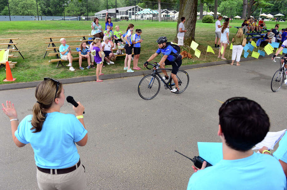 Luis Wilmor, of Norwalk, crosses the finish line during the annual CT Challenge charity bike ride, held at Fairfield County Hunt Club in Westport, Conn. on Saturday July 26, 2014. About 1000 riders gathered as individuals and in teams to raise money to help cancer survivors. There were several routes riders took part in, from 10 miles up to 100 miles. Photo: Christian Abraham / Connecticut Post