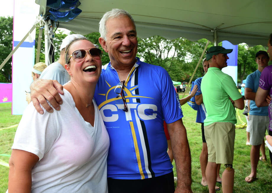 Former Major League Baseball player and manager Bobby Valentine poses for a photo with Lori Slavin, of Fairfield, after taking part in the annual CT Challenge charity bike ride held at Fairfield County Hunt Club in Westport, Conn. on Saturday July 26, 2014. About 1000 riders gathered as individuals and in teams to raise money to help cancer survivors. There were several routes riders took part in, from 10 miles up to 100 miles. Photo: Christian Abraham / Connecticut Post