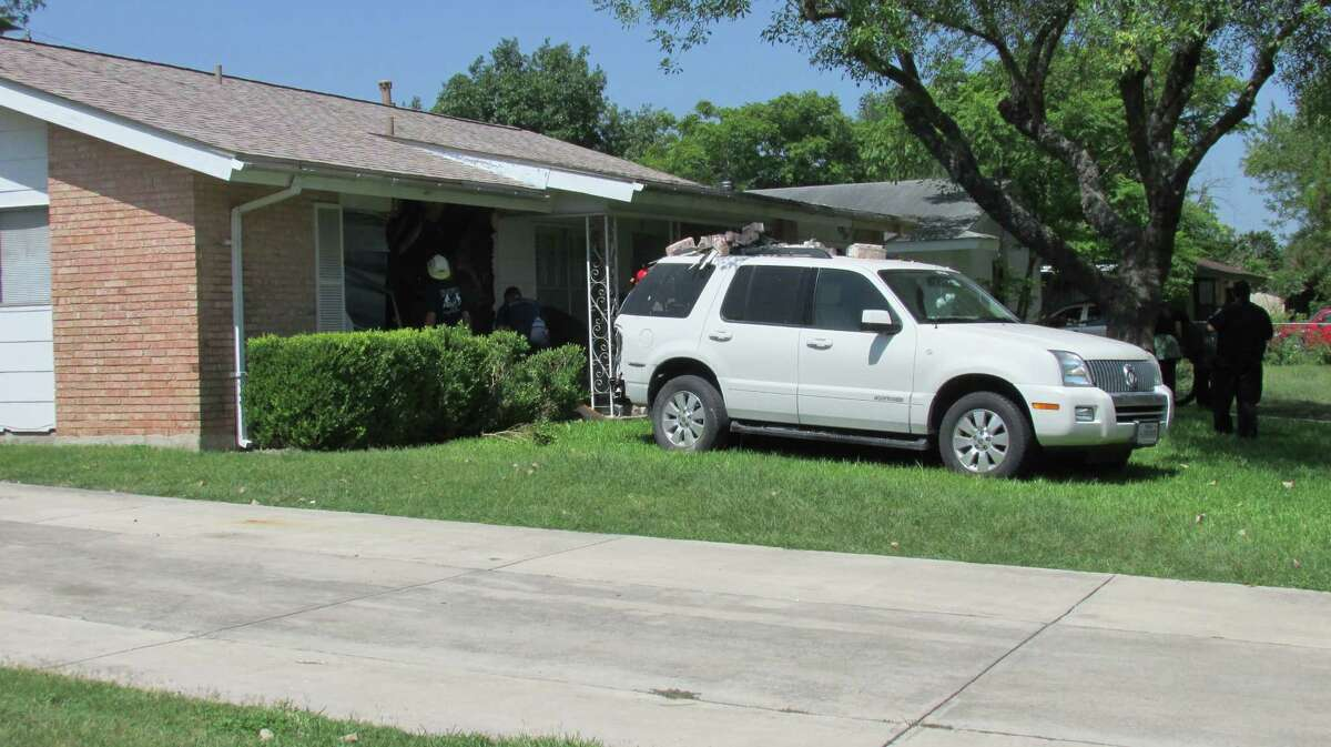 An elderly man backed into a house in the 5100 block of Village Way on Saturday morning, July 26, 2014.