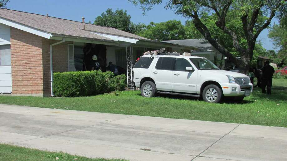 An elderly man backed into a house in the 5100 block of Village Way on Saturday morning, July 26, 2014. Photo: Mark D. Wilson/San Antonio Express-News